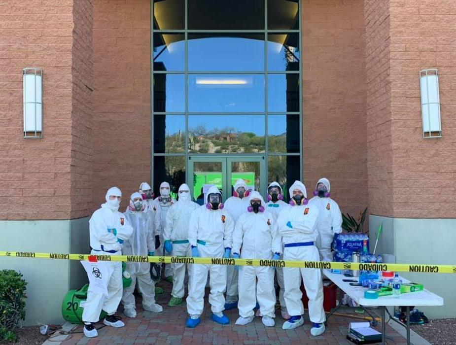 A group picture of our crew wearing PPE for a virus clean up job
